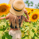 Young girl enjoying nature on the field of sunflowers - PhotoDune Item for Sale