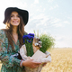 Photo of happy young woman smiling while walking with basket at picnic - PhotoDune Item for Sale