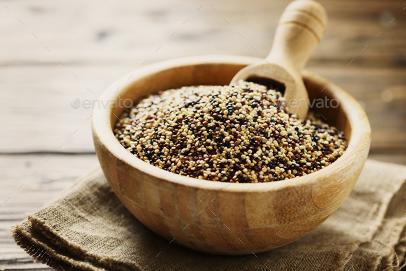 Mix of raw red, white and black quinoa on thw wooden table - Stock Photo - Images