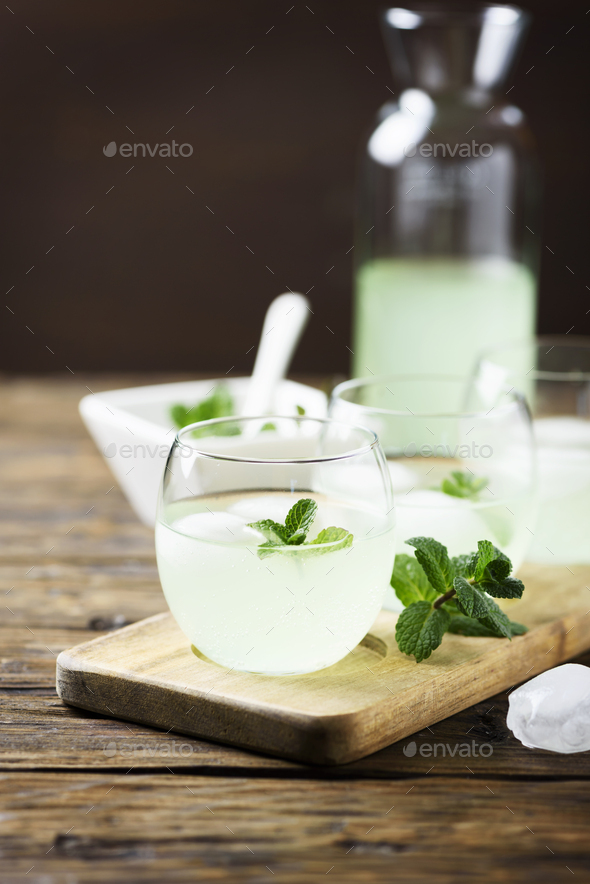 Summer cocktail with rum, ice and mint - Stock Photo - Images