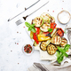 Grilled colorful vegetables, aubergines, zucchini, pepper with spice and green basil - PhotoDune Item for Sale