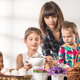Charming young woman sets the table for children - PhotoDune Item for Sale