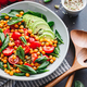 Fresh healthy salad with chickpea, avocado, cherry tomatoes and spinach. - PhotoDune Item for Sale