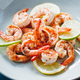 Fried tiger shrimp with lime, lemon and spices on a ceramic dish - PhotoDune Item for Sale