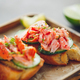 Toasts with fresh cucumber and smoked salmon served with lime shavings - PhotoDune Item for Sale