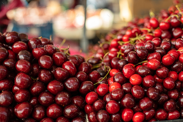 Stack of sweet cherry at the market - Stock Photo - Images