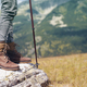 woman with leather boots and hiking stick on mountain - PhotoDune Item for Sale