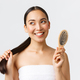 Beauty, hair loss products, shampoo and hair care concept. Dreamy beautiful asian girl in bath towel - PhotoDune Item for Sale