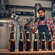 Indianr male manufacturer presenting craft beer in the microbrewery. - PhotoDune Item for Sale