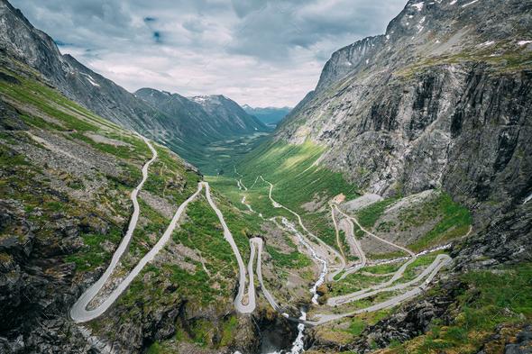 Trollstigen, Andalsnes, Norway. Cars Goes On Serpentine Mountain Road Trollstigen. Famous Norwegian - Stock Photo - Images