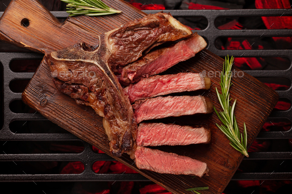 T-bone beef steak cooking on grill - Stock Photo - Images