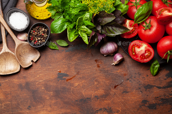 Italian cuisine ingredients. Tomatoes, herbs and spices - Stock Photo - Images