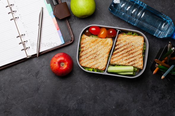 Healthy lunch box with sandwich and vegetables - Stock Photo - Images