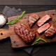 Grilled beef steaks on cutting board - PhotoDune Item for Sale