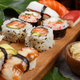 Sushi Set nigiri and sushi rolls on a wooden tray - PhotoDune Item for Sale