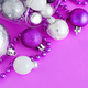 Christmas baubles in a wine glass on a purple background - PhotoDune Item for Sale