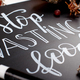 Chalkboard with Stop wasting food lettering - PhotoDune Item for Sale