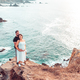 Pregnant couple on the edge of a cliff - PhotoDune Item for Sale