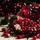Break Azerbaijan pomegranate on an old table in a rustic style - PhotoDune Item for Sale