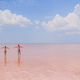 Girls on a pink salt lake on a sunny summer day - PhotoDune Item for Sale