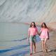 Adorable little girls having fun on the beach - PhotoDune Item for Sale