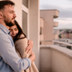 Man and woman on balcony at sunset in the city - PhotoDune Item for Sale