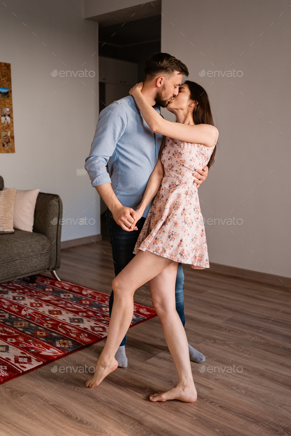 Man and woman dancing in a modern interior - Stock Photo - Images