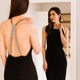 Lady wears beautiful black dress looking into the mirror - PhotoDune Item for Sale
