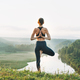 Young woman girl practice yoga looking on beautiful landscape on early morning - PhotoDune Item for Sale