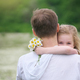 Father and daughter in camomile meadow. - PhotoDune Item for Sale