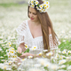 Cute girl in camomile meadow. - PhotoDune Item for Sale