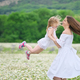 Happy mother and daughter in camomile meadow - PhotoDune Item for Sale