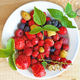 Berries on a plate on a wooden board - PhotoDune Item for Sale