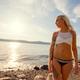 Portrait Of Beautiful Young Woman Looking Away In Bikini At Beach - PhotoDune Item for Sale