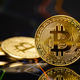 Gold bitcoin standing on financial charts for cryptocurrency prices - PhotoDune Item for Sale