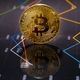Closeup Of Gold Bitcoin Over Value Graph - PhotoDune Item for Sale
