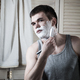 Portrait of a young man shaving his face - PhotoDune Item for Sale