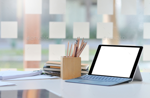 Close-up shot of Tablet mockup blank screen on desk in comfortable office. - Stock Photo - Images