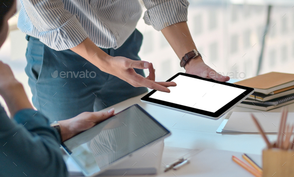 Close-up shot of Freelance team used a blank screen tablet to design new projects in the office. - Stock Photo - Images