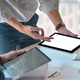 Close-up shot of Freelance team used a blank screen tablet to design new projects in the office. - PhotoDune Item for Sale