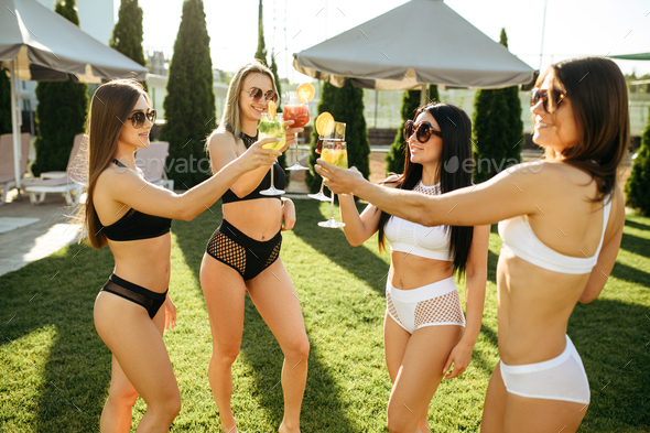 Sexy women with fresh coctails, pool party - Stock Photo - Images