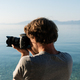 Young male photographer taking photos of beautiful summer landscape - PhotoDune Item for Sale