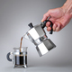 Man's hand holding and pouring italian coffee into a Glass cup - PhotoDune Item for Sale