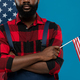 Young bearded repairman of African ethnicity in workwear holding American flag - PhotoDune Item for Sale