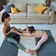Pretty young woman helping her positive teenage daughter with yoga exercise - PhotoDune Item for Sale