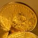 Closeup of gold bitcoin on yellow backgound - PhotoDune Item for Sale