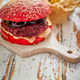 Homemade vegetable beetroot burgers. Red colored sesame bun. Served with goat cheese, feta - PhotoDune Item for Sale