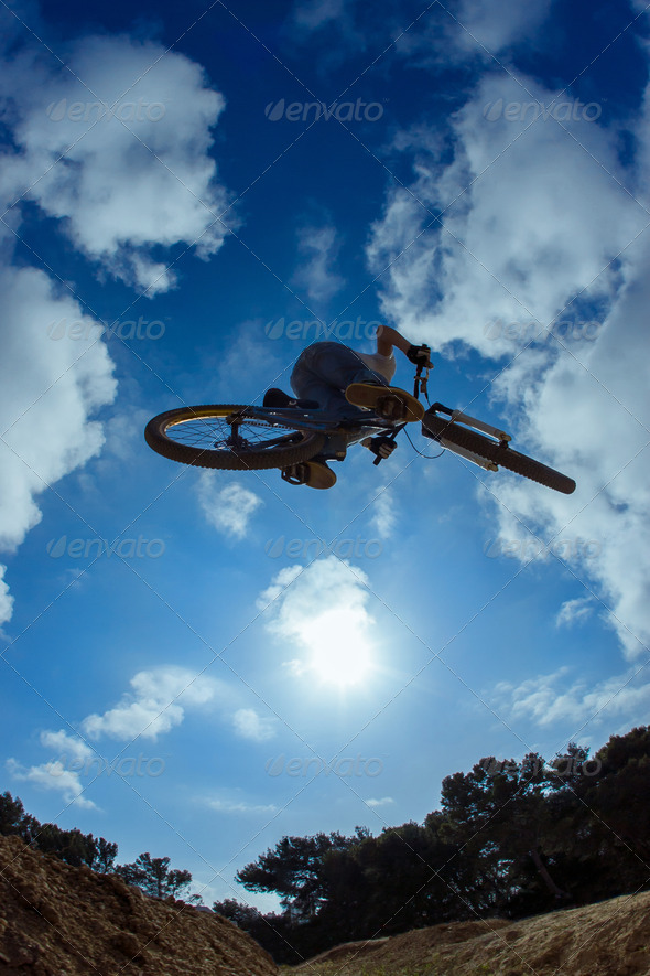Mountain biker jumping - Stock Photo - Images