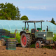 Old tractor on a field with seedlings in boxes. - PhotoDune Item for Sale
