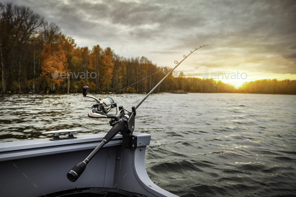 Fishing rod on the boat. Autumn season - Stock Photo - Images
